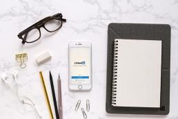 Phone on table with LinkedIn app opened