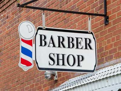 Hanging sign for a barber shop