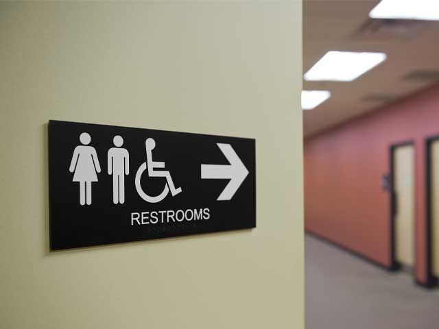 Indoor office sign for restrooms