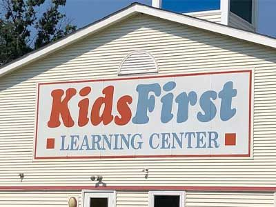 Storefront metal sign for Kids First Learning Center