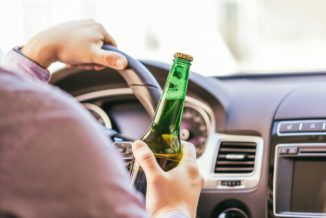 The driver drinking alcohol while driving