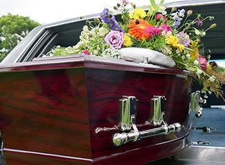 wrongful death casket with flowers