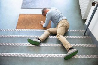 slip and fall victim struggling in a staircase
