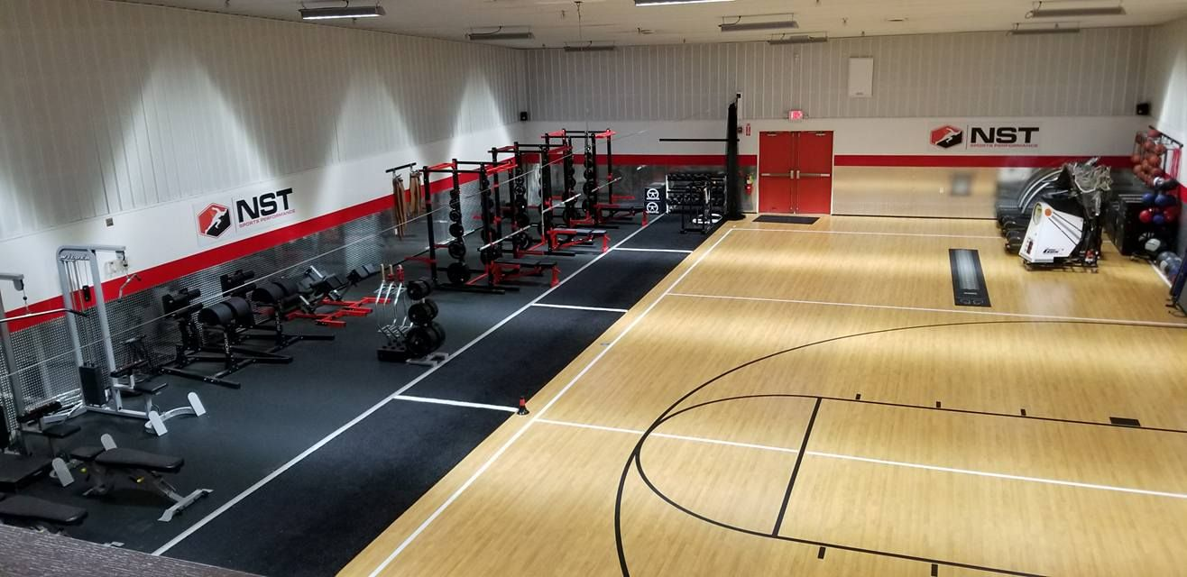 Nst Fit Gym workout area with basket ball court