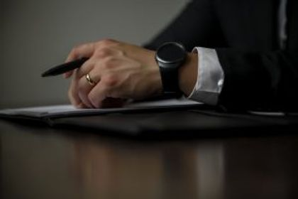 Canton, GA lawyer holding a pen during a free consultation