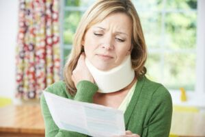 Injured woman looking at letter