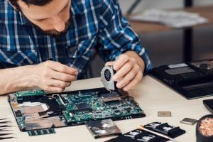 Man working on the motherboard