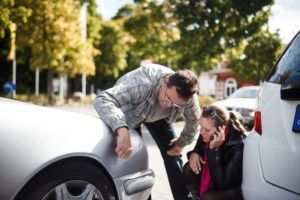 looking at car accident damage