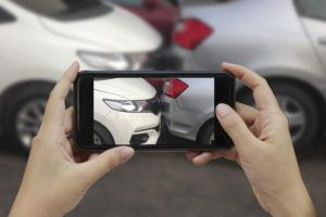 taking a picture for insurance after a car accident in Montgomery, AL