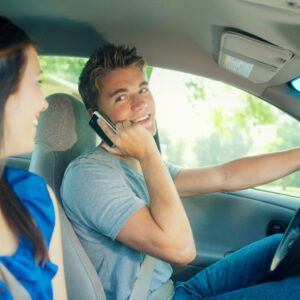 teen driving while talking on phone