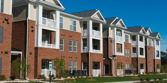 An apartment building with porches.