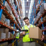 A worker scans a package in an industrial property rental.