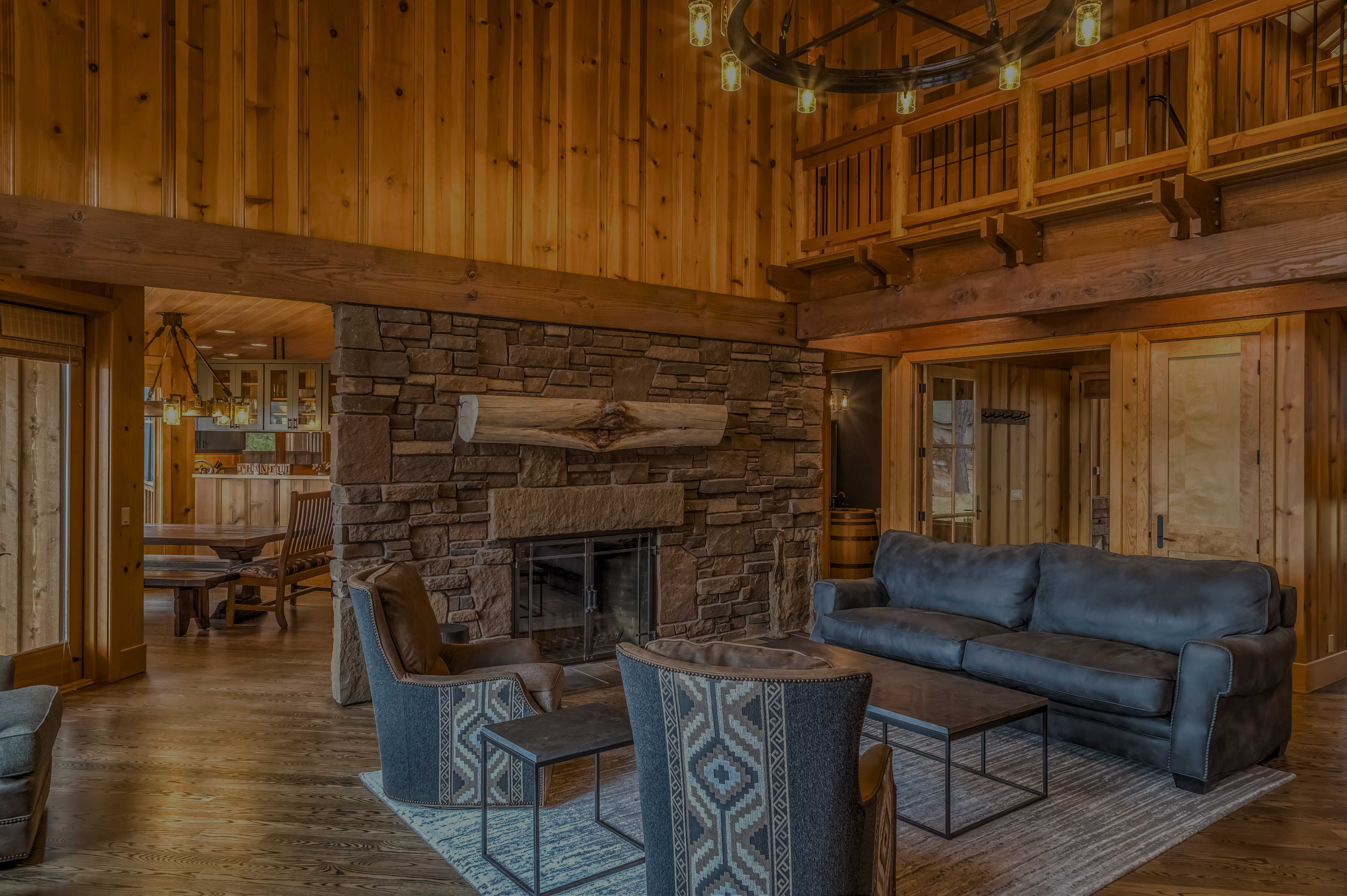wooden interior of residential home with stone fireplace