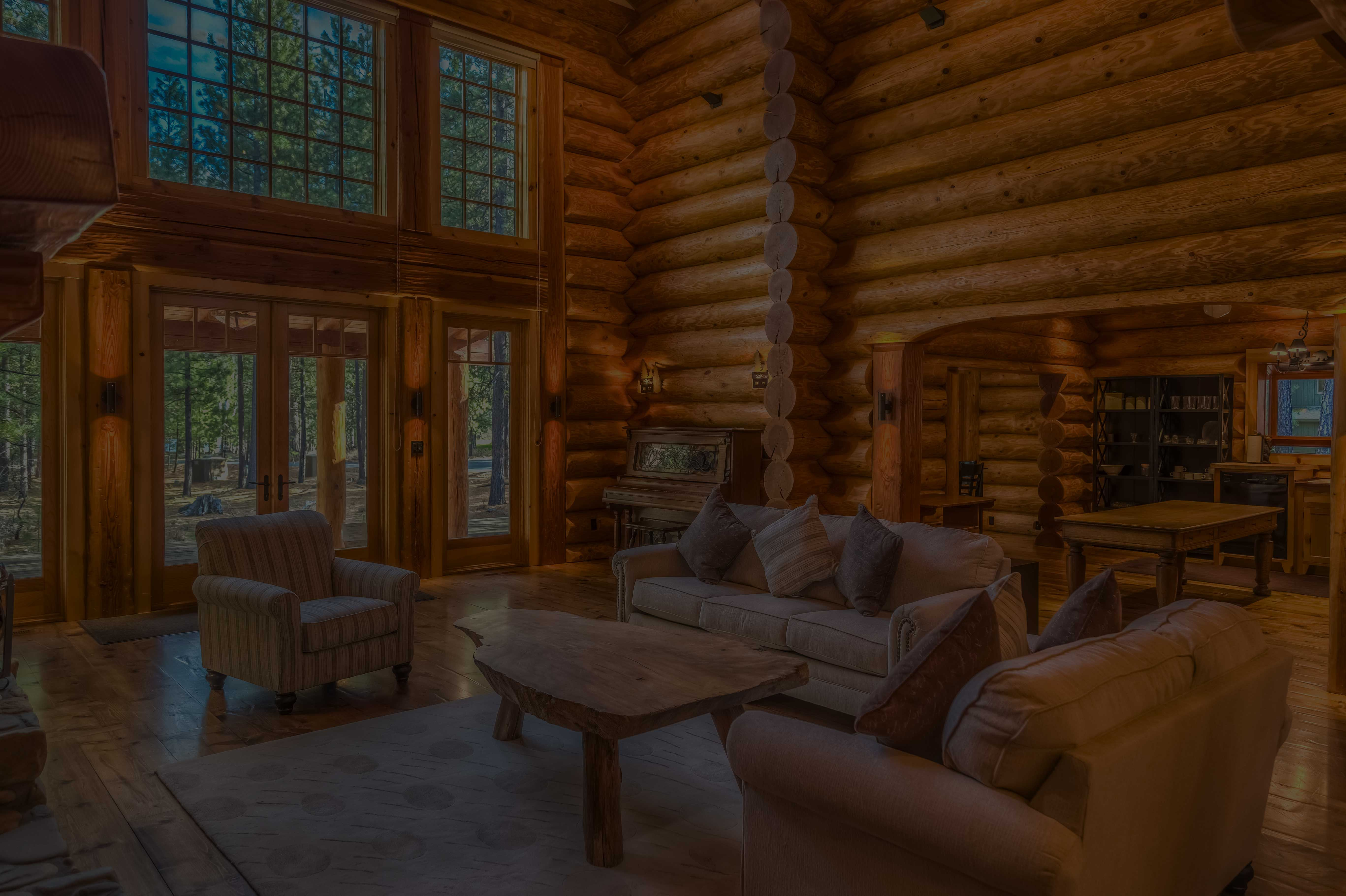 log cabin interior with huge windows open concept
