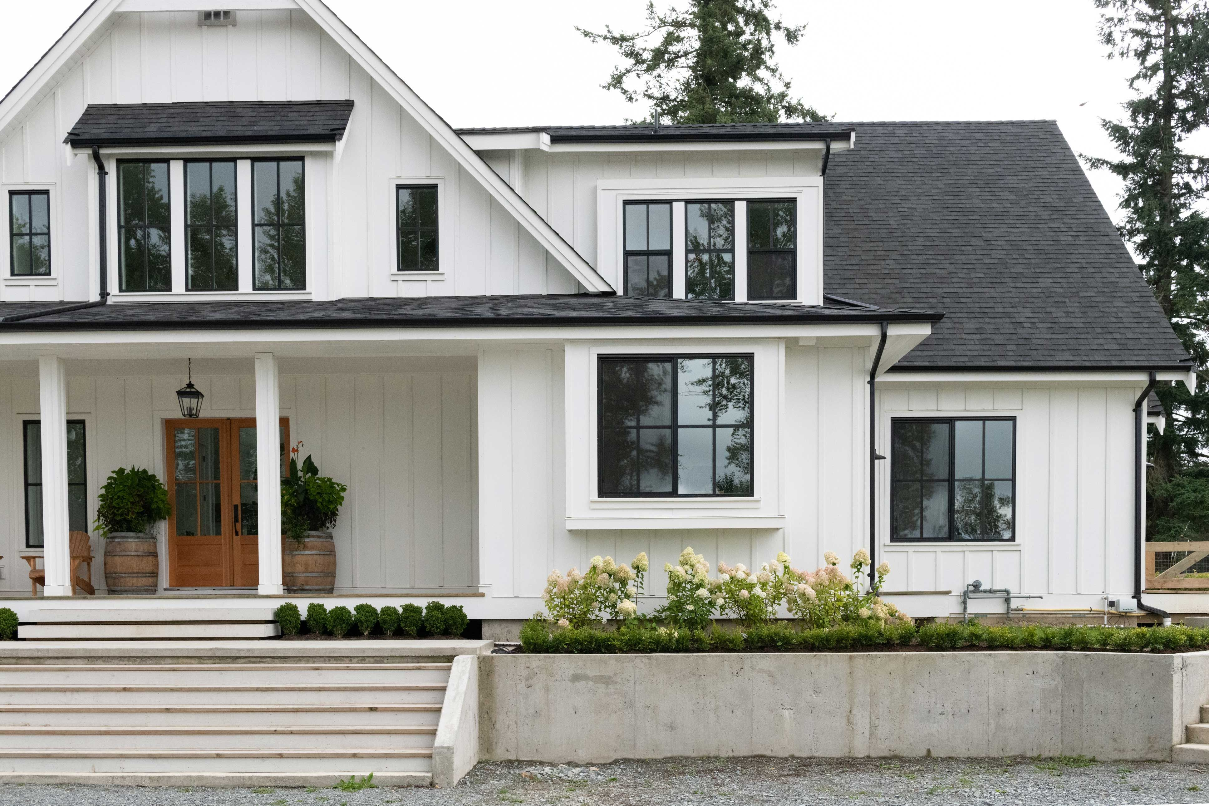 beautiful modern residential home with black and white color scheme