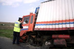 Police investigating truck accident.