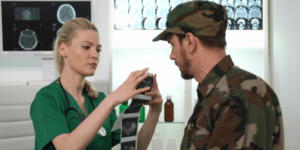 military doctor talking to a soldier