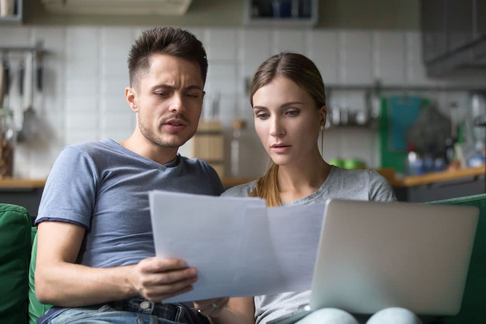 couple looking at debt