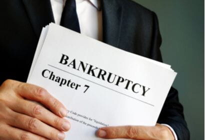 man holding chapter 7 bankruptcy paperwork