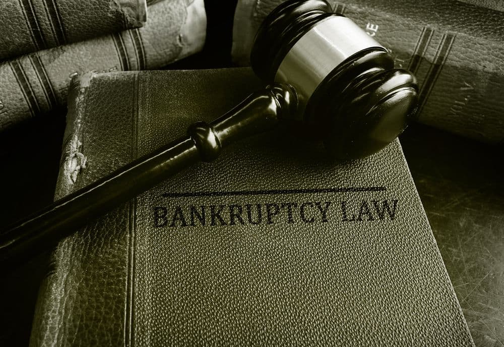 Gavel on top of bankruptcy law book