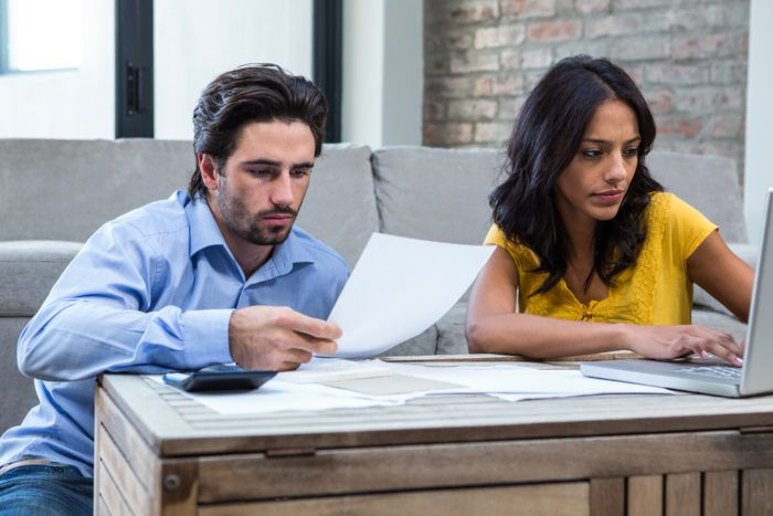 Couple examining their bankruptcy options