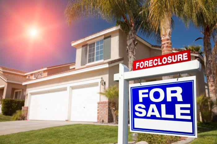 For sale sign on a foreclosed home in Florida