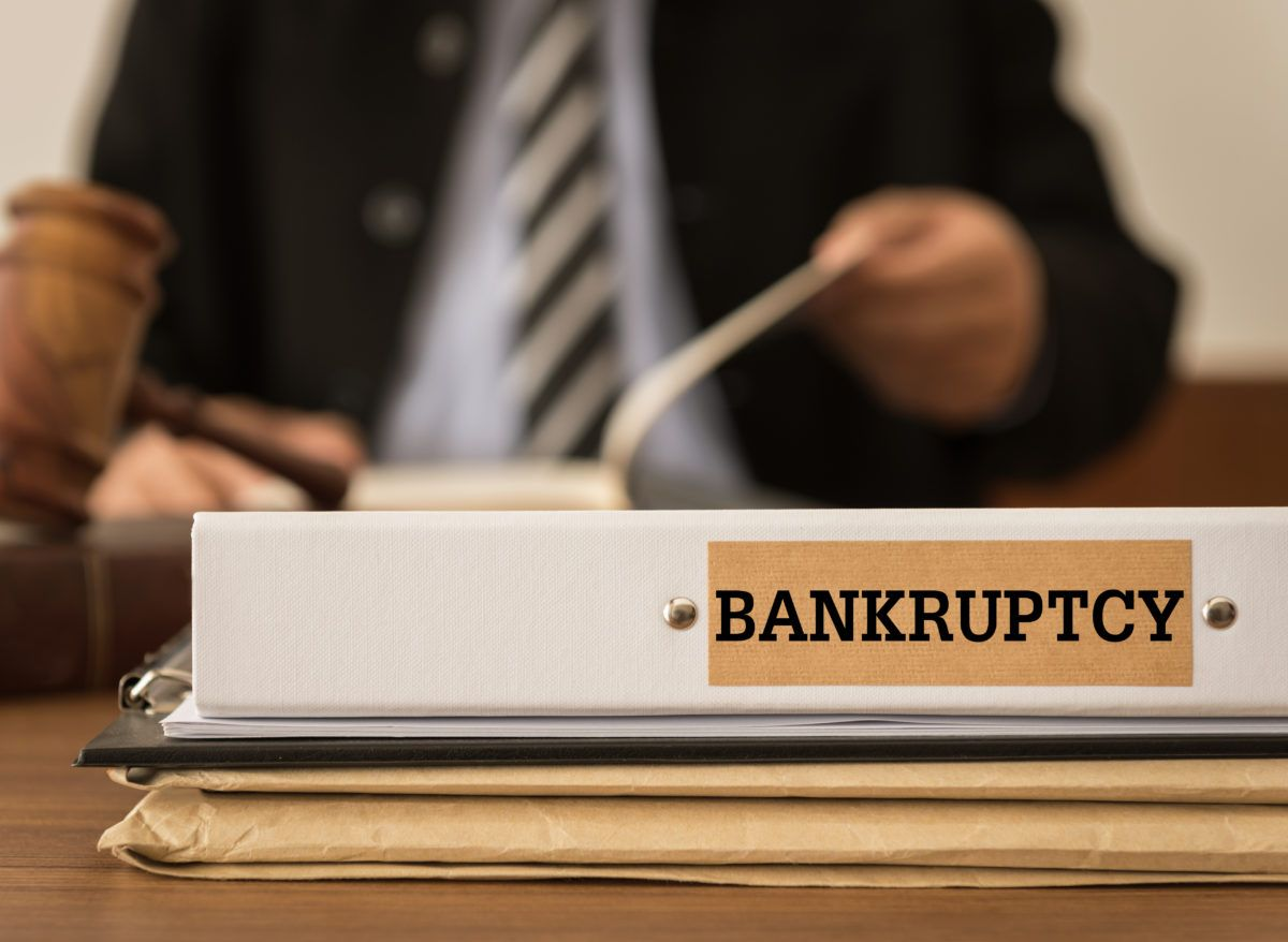 Bankruptcy document folder with lawyer at the law firm.