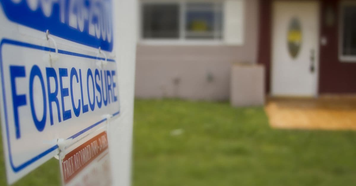 foreclosure sign outside of a house.