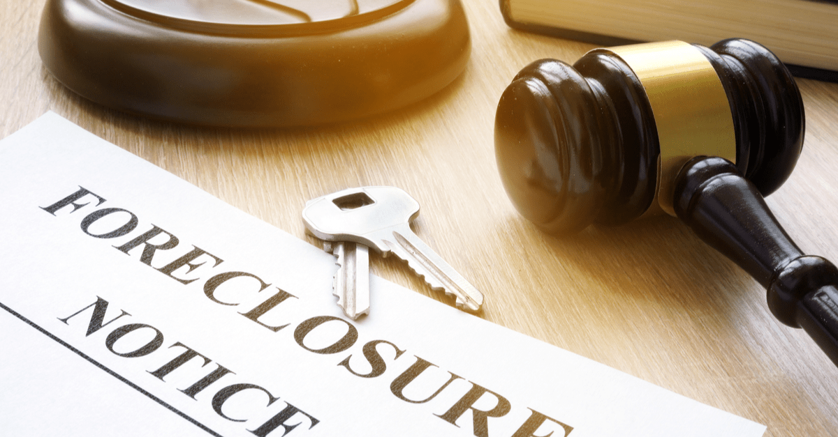 foreclosure notice and keys on court table