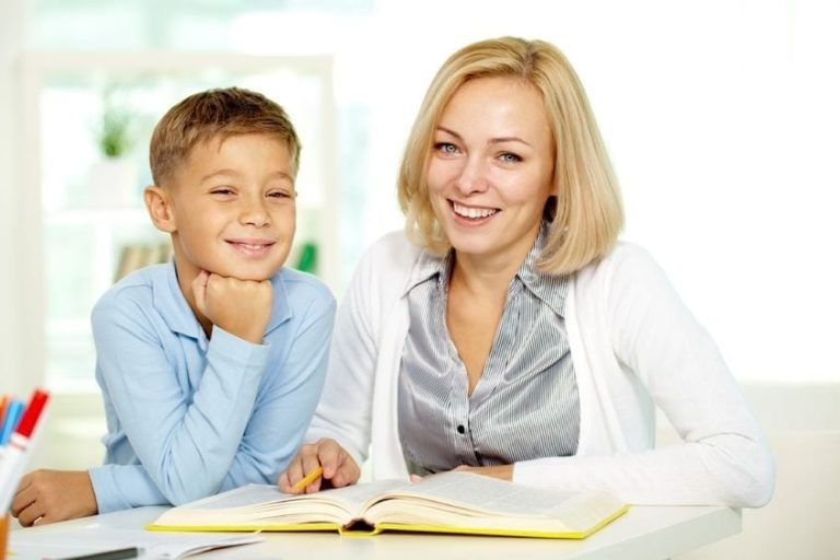 A LADY TUTOR & A BOY STUDENT SMILING. MATH AND ENGLISH TUTORING SERVICE IN GREATER VANCOUVER WITH HACK YOUR COURSE