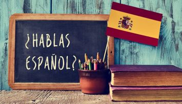"""Blackboard with """"Can you speak Spanish"""" on it and Spanish Flag. Hack your course Spanish tutoring service in West Vancouver"""