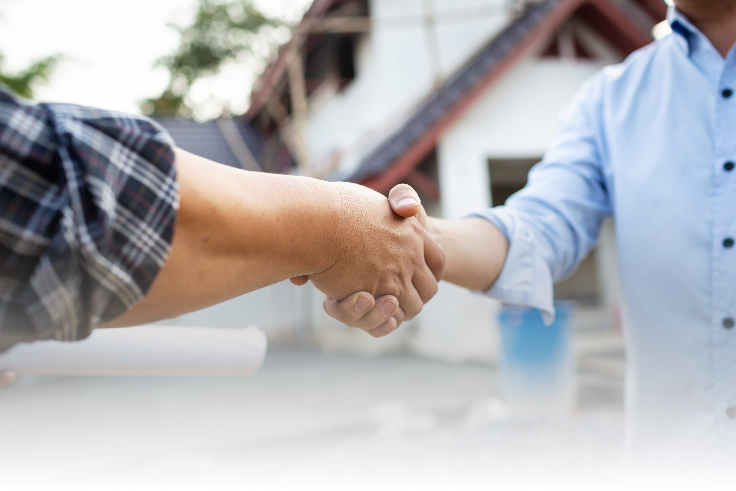 shaking hands at remodeling site