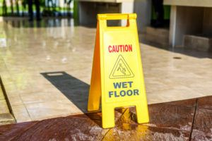 slip and fall sign marking wet floor