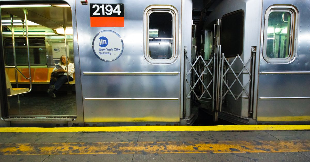 Subway car with passenger in NYC at station