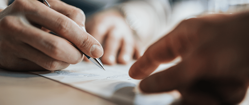 Personal injury lawyers signing papers