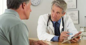 Doctor meeting with a patient on Long Island to avoid a medical malpractice case.