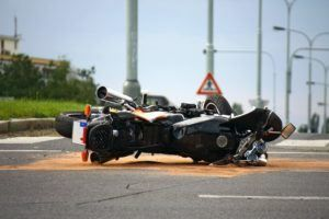 motorcycle laying on a road after accident