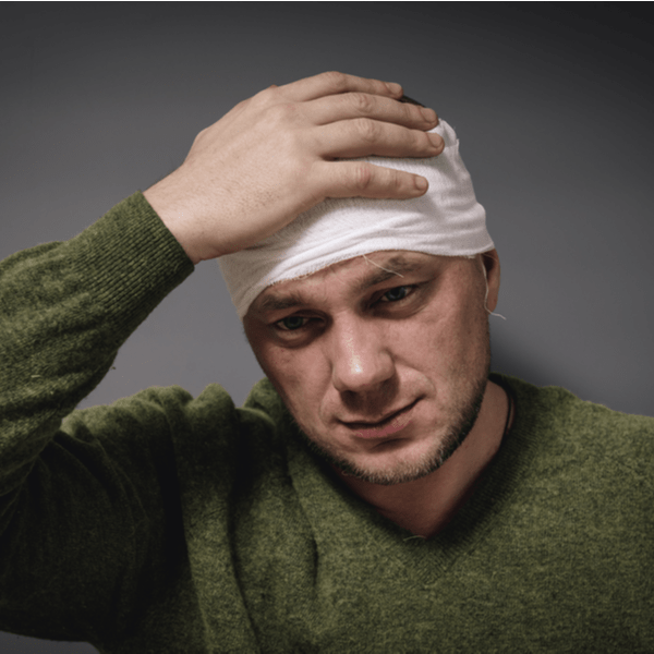 a man with a head tied by bandage