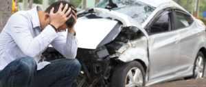 man frustrated after a car accident