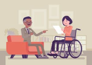 a social security disability attorney talking to a disabled woman sitting on a wheelchair while reading a document