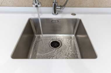 Empty Sink with the Faucet Turned On in Houston