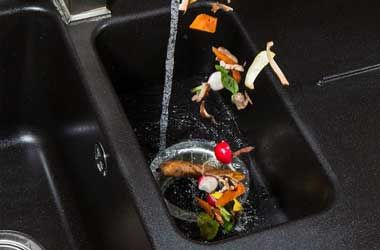 Food Falling Into a Garbage Disposal in Houston