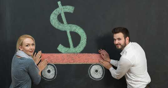 Woman and Man in Houston Pointing to a Drawing of Money Saved