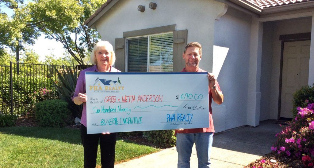 Our clients, Greg & Neita, participated in the Buyers Incentive program, pictured here in front of their new home