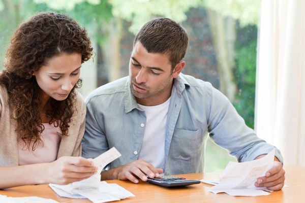A couple prepare their finances together. How do you figure out how much you can afford to pay for a home, our First-Time Homebuyers Guide has advice