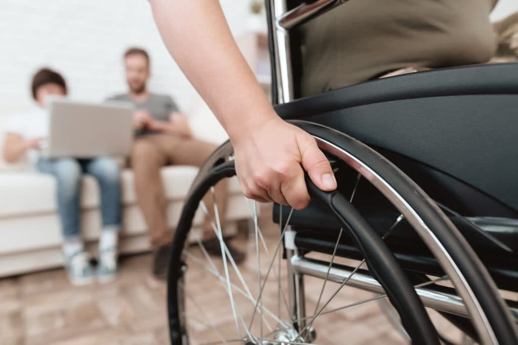 Disabled woman moving away from family.