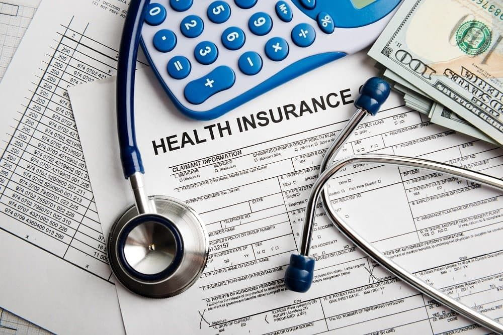 Health insurance application form with banknote and stethoscope concept for life planning.