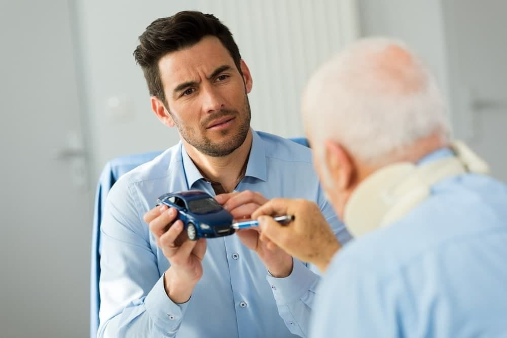 Injured old man talking to his insurance agent.