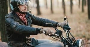 Motorcycle rider wearing safety gears.
