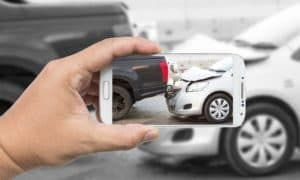 A Colorado Springs car accident lawyer takes a photo of a crash for evidence.